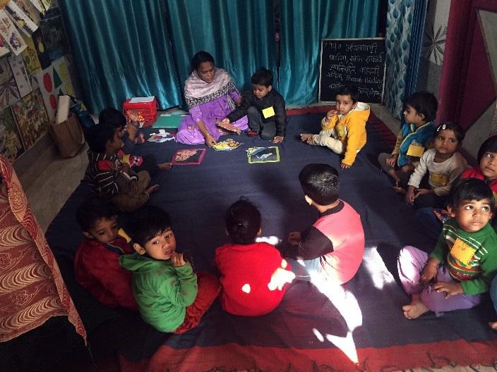 children sit in a circle