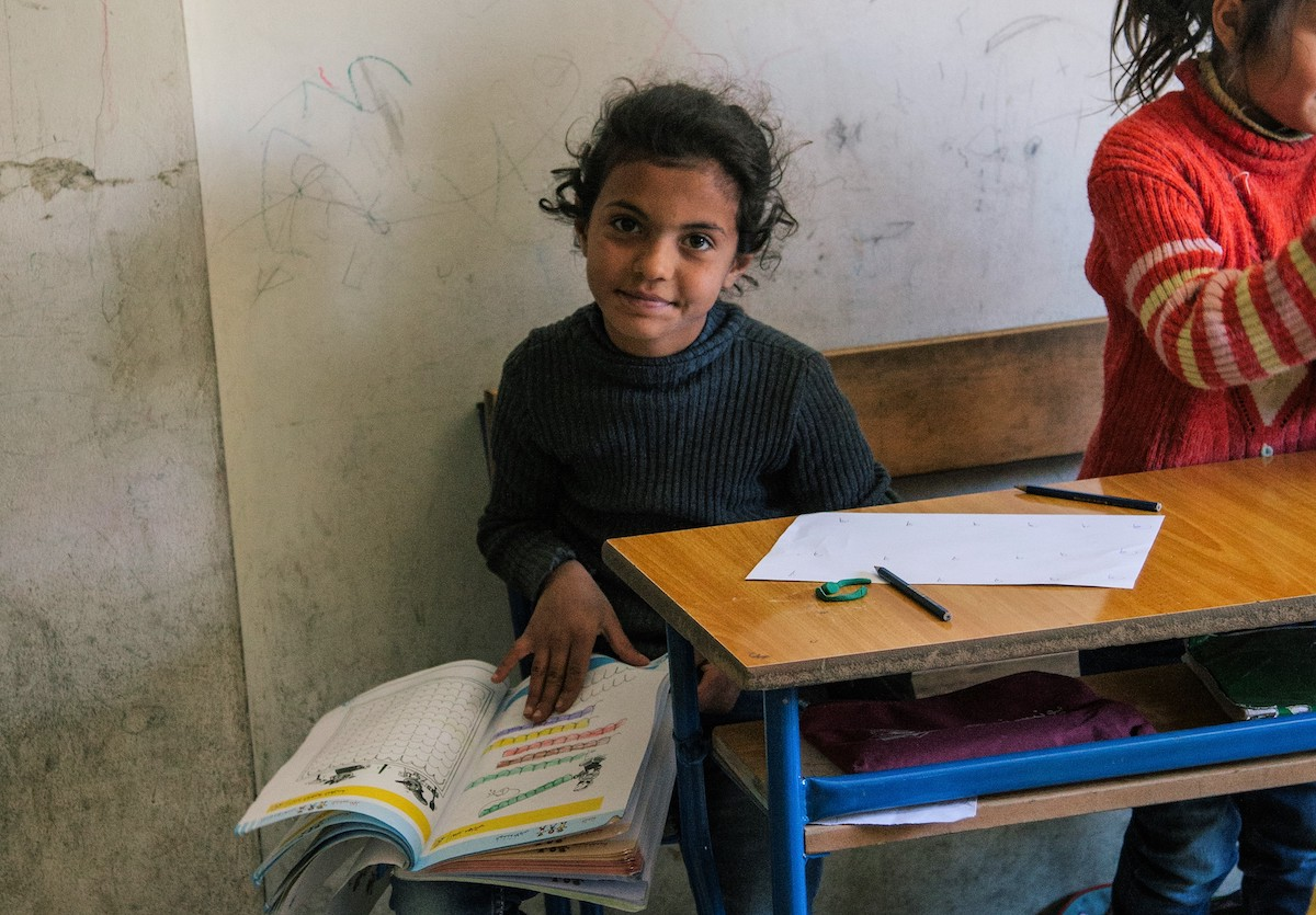 A girl who is a refugee in Lebanon, at a school supported by the Luminos Fund. Photo by Luminos Fund.