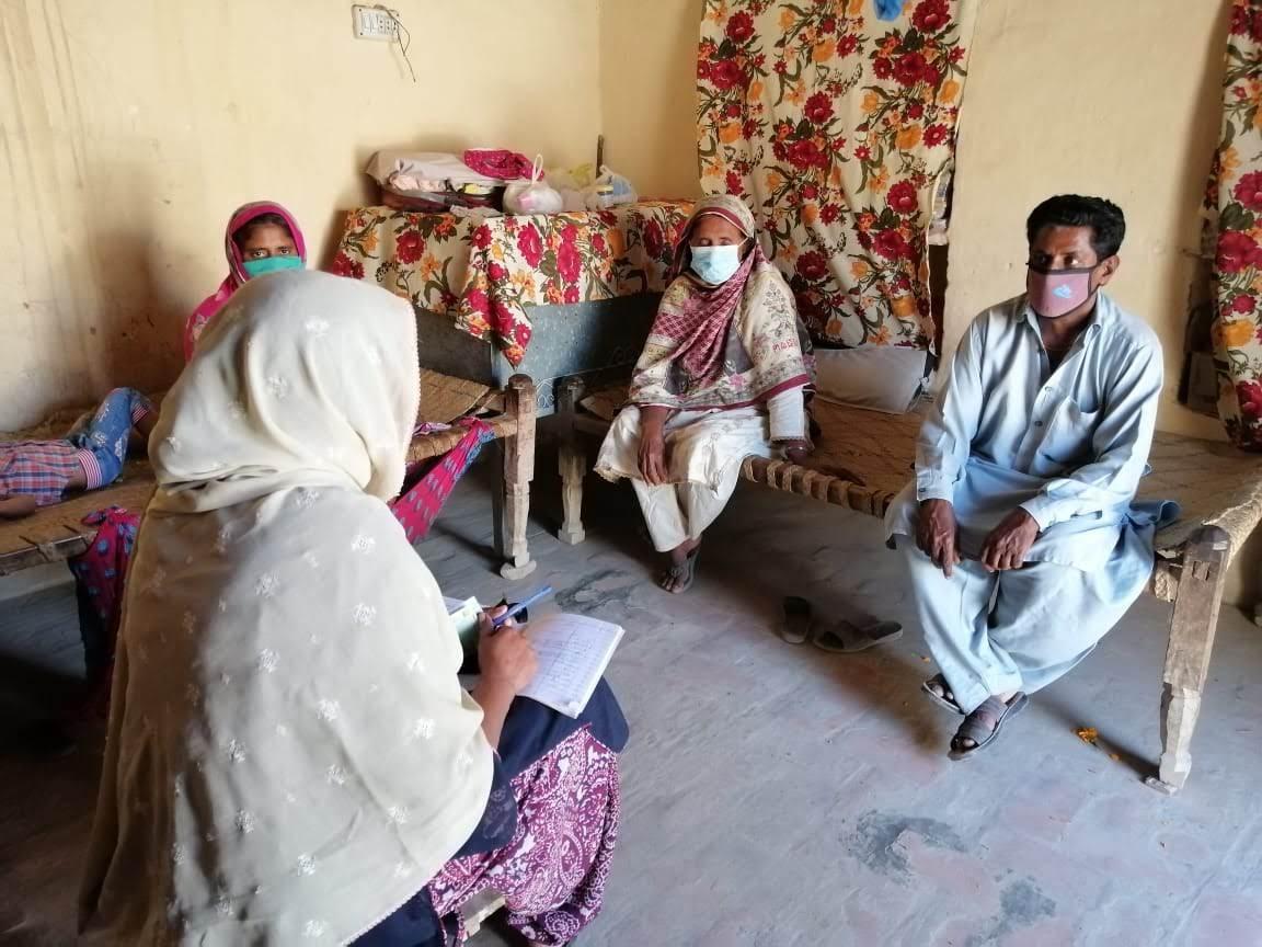 A TCF surveyor in a village in Pakistan.