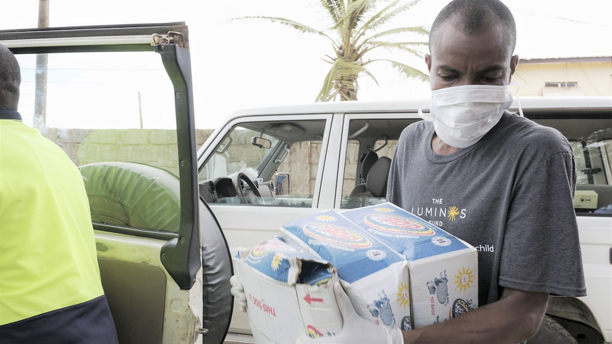 Alphanso Menyon loads a car for distribution of supplies in Liberia
