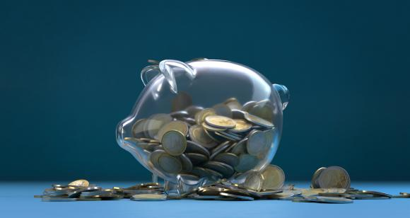 A stock photo of a see-through piggy bank. Adobe Stock.