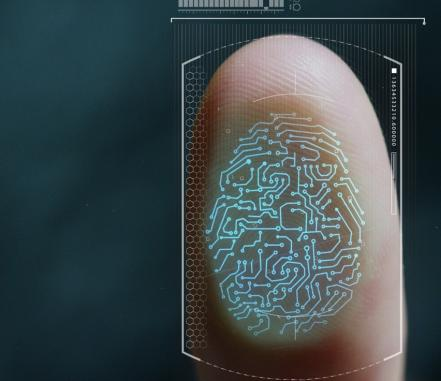 A thumb being biometrically scanned. Adobe Stock