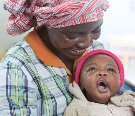 A woman smiles at her baby
