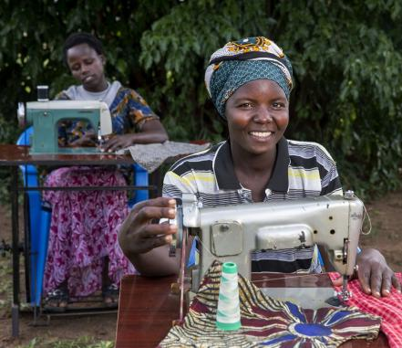 A Ugandan woman working at a sewing machine. Photo by Jonathan Torgovnik/Getty Images via Images of Empowerment