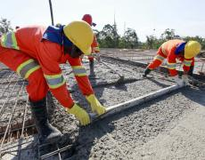 Construction workers laying a road