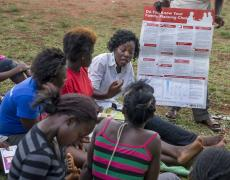 A member of the Youth Foundation for Christ Ministries in Uganda gestures during an outreach to sensitize young women from the Baroma school about family planning and sex education. This activity was on a soccer pitch near their school.