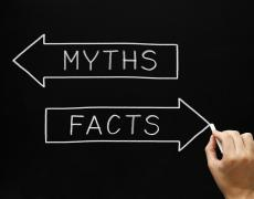 "A hand pointing to the text ""myths"" and ""facts"""