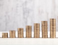 Stock image of rising piles of coins. Adobe Stock