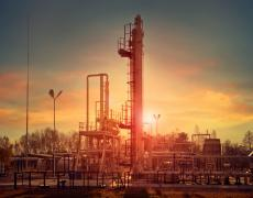 Sunset at a natural gas plant. Adobe Stock