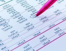 Stock photo of a spreadsheet with several numbers circled in pen