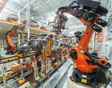 Robots on a factory assembly line