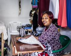 smiling woman at sewing machine
