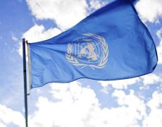The United Nations flag over a sky backdrop