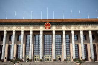 A shot of the front of the Great Hall of the People in Beijing. Adobe Stock